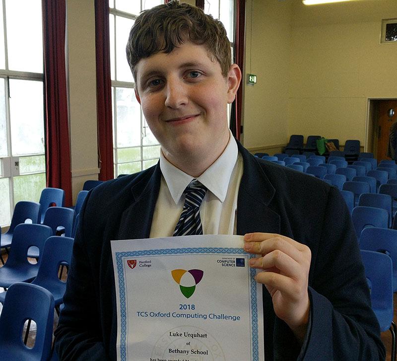 Luke receiving his certificate
